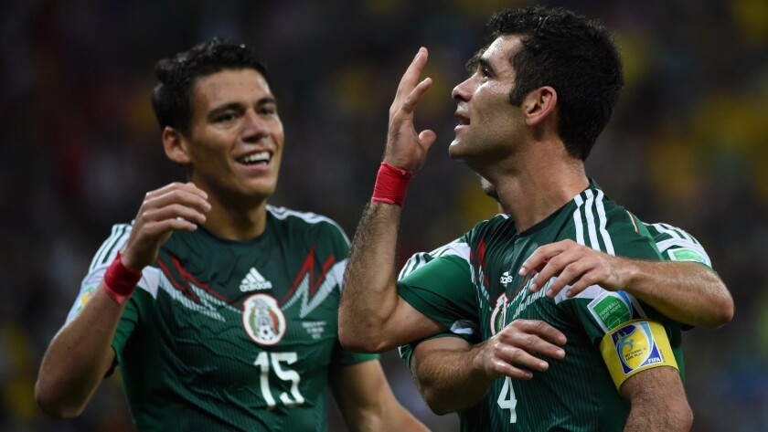 Mexico defender Rafael Marquez, right, celebrates with teammate Hector Moreno, left, after scoring his team's first goal in a 3-1 World Cup victory over Croatia on Monday.