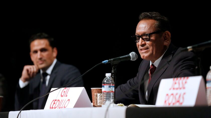 Challenger Joe Bray-Ali, left, and incumbent Gil Cedillo discuss issues earlier this month at a forum for City Council District 1 candidates.