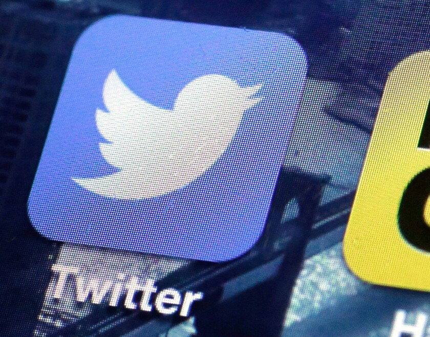 A Twitter app icon is shown on a smartphone screen. Four Twitter executives are leaving the San Francisco company.