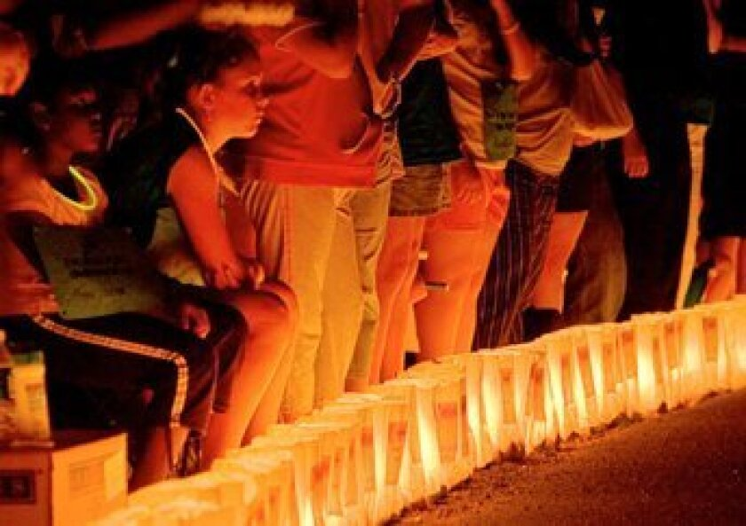 A luminaria ceremony is part of the 24-hour Relay for Life, which honors those fighting cancer and those who have fought the disease.