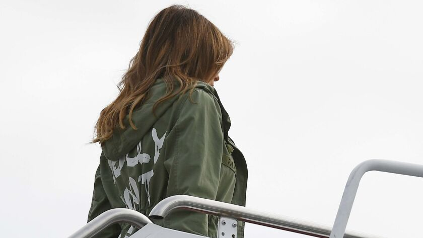 First Lady Melania Trump boards a flight at Andrews Air Force Base in Maryland wearing a Zara jacket that asked a pointed question.