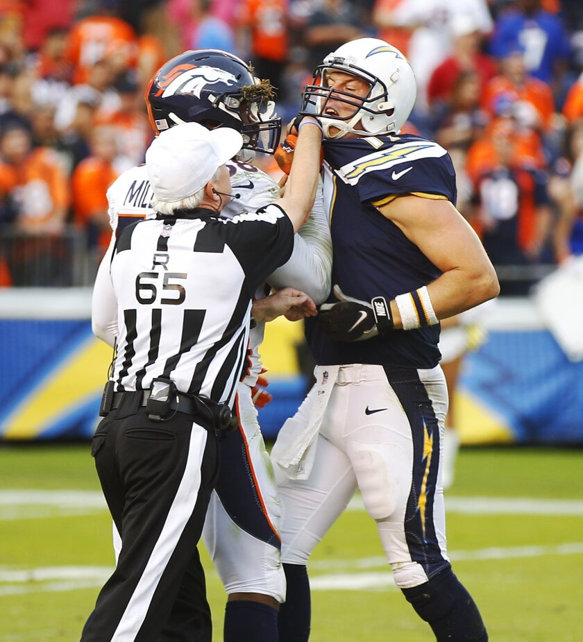 Chargers Philip Rivers and Broncos Von Miller get into it  during the final moments of the 4th quarter.