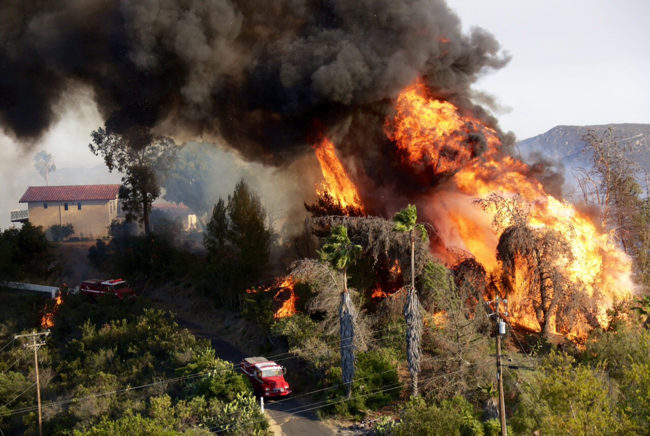 A huge fireball erupts as a structure burns on Coronado Hills Drive in San Marcos.