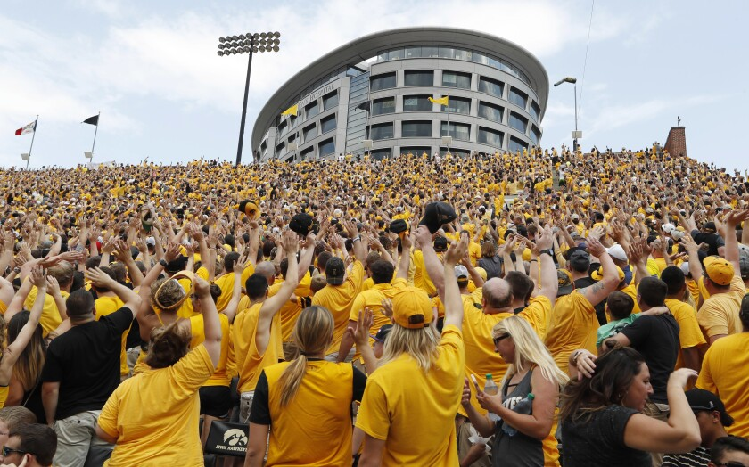 The Wave, a tradition where everyone at Kinnick Stadium in Iowa City, Iowa, waves to kids being treated at a neighboring hospital, is coming to San Diego for the Dec. 27 game between Iowa and USC.