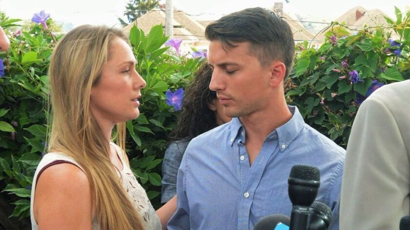 Denise Huskins and Aaron Quinn appear at a news conference in Vallejo on July 13, 2015. The couple has reached a settlement in a lawsuit against the city and its police department.