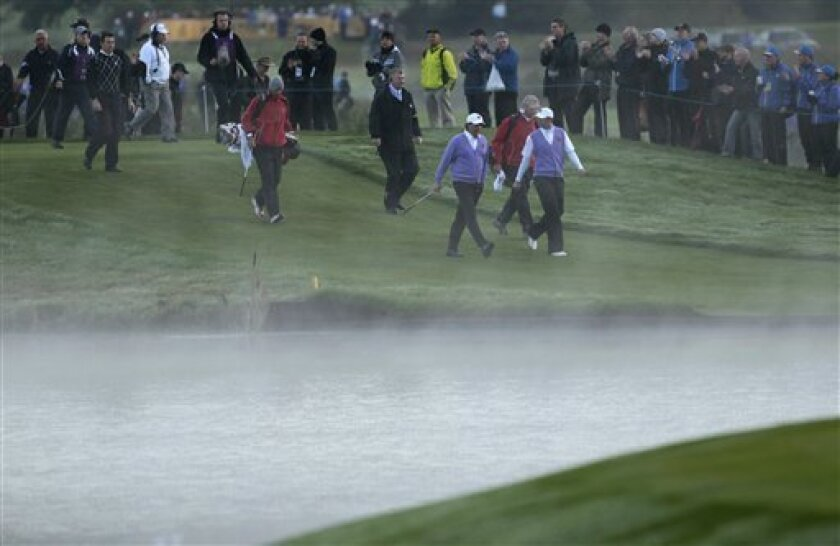 U.S. team members Phil Mickelson, third right, and Dustin Johnson, right, walk the 13th fairway on the second day of the 2010 Ryder Cup golf tournament at the Celtic Manor Resort in Newport, Wales, Saturday, Oct. 2, 2010. (AP Photo/Matt Dunham)