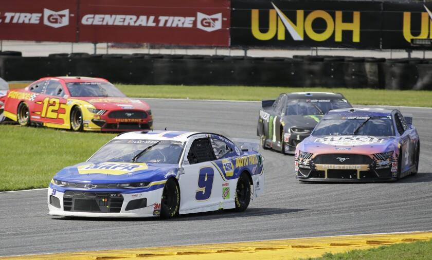 Chase Elliott, front, leads Kevin Harvick, Kurt Busch and Ryan Blaney through Turn 3.