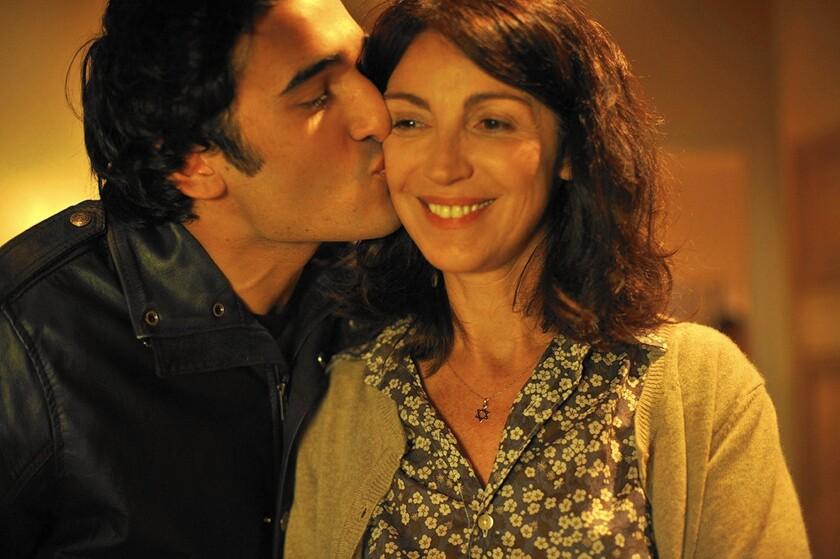 """Ilan Halimi (Syrus Shahidi) kisses his mother (Zabou Breitman) in the movie """"24 Days."""""""