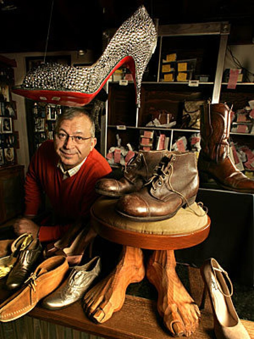 Pasquale Fabrizio, owner of Pasquale shoe repair on San Vicente Blvd in Los Angeles.