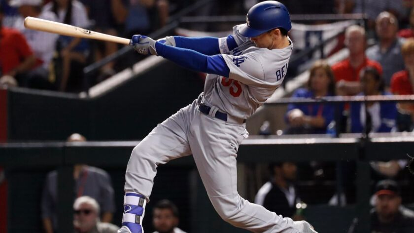 The Dodgers' Cody Bellinger connects for a solo home run during the fifth inning in Game 3 of the NLDS against the Arizona Diamondbacks on Monday.