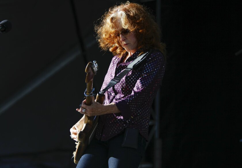 Bonnie Raitt plays he guitar at the Zuma stage.