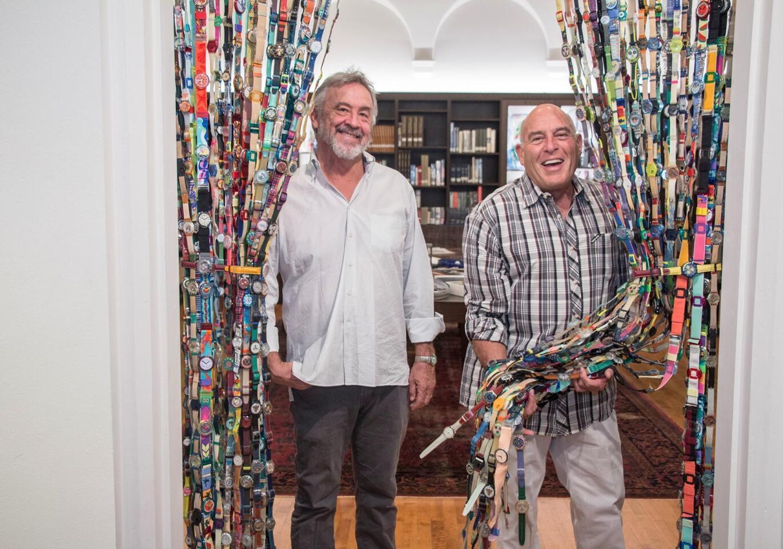 Mark Quint and Roy Porello pose with Porello's 1000-Swatch curtain.