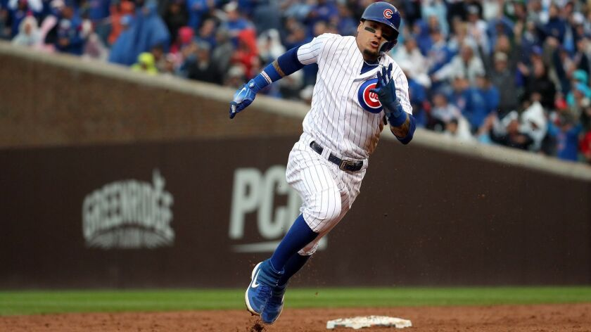 The Chicago Cubs' Javier Baez heads for the plate against the St. Louis Cardinals on Sept. 30 at Wrigley Field.