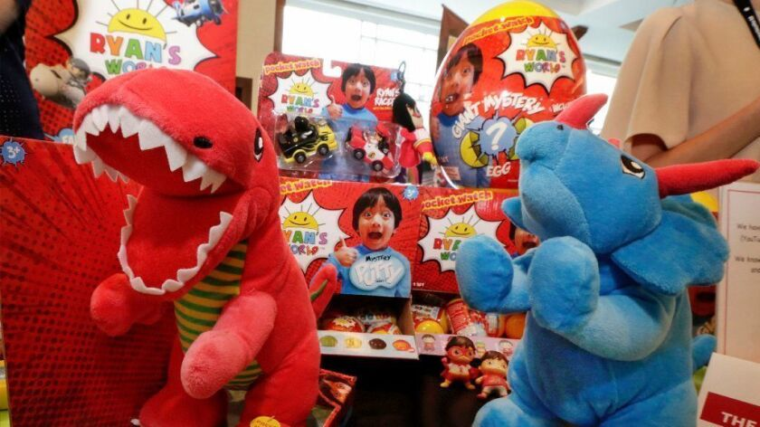 Ryan's World toys, from Bonkers Toys, are displayed on July 11, 2018, at the The Toy Insider Sweet Suite show, in New York. Seven-year-old Ryan drew millions of views reviewing toys on YouTube. Now, he's become a toy himself.