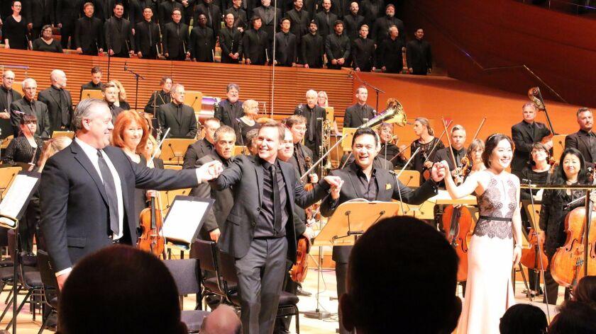 Baritone Stephen Powell, left, with conductor Grant Gershon, tenor Nicholas Phan and soprano So Youn