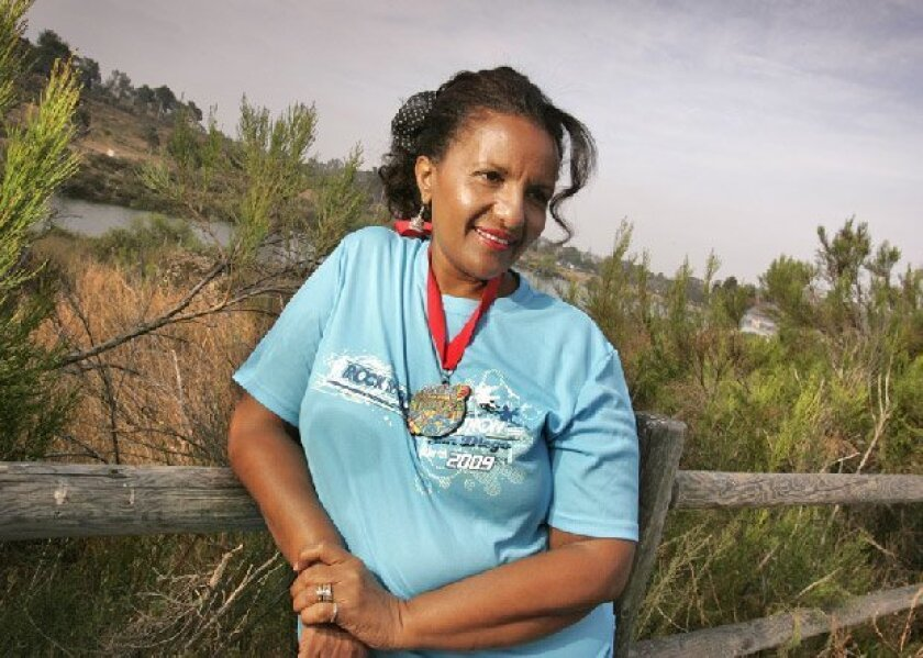 Aster Parker of San Carlos, who was born in the East African country of  Eritrea, has faced circumstances much more difficult than conquering 26.2  miles in the Rock 'n' Roll Marathon. (Howard Lipin / Union-Tribune)