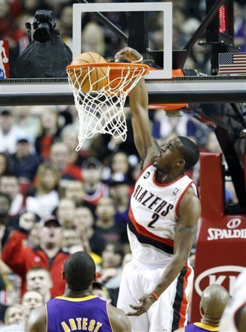Portland Trail Blazers' Wesley Matthews (2) dunks the as Los Angeles Lakers' Ron Artest (15) looks on in the second quarter during their NBA basketball game Friday, April 8, 2011, in Portland, Ore.(AP Photo/Rick Bowmer)