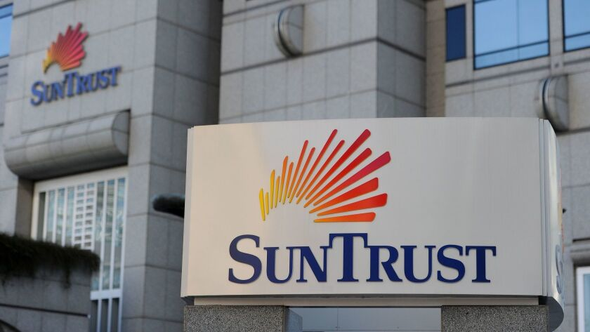 SunTrust, BB&T banks merge, Atlanta, USA - 15 Mar 2012
