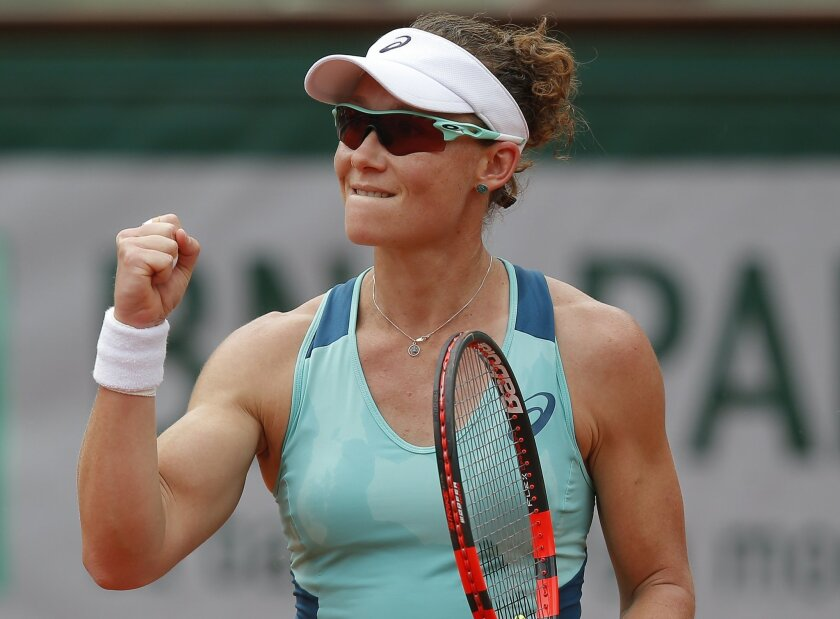 Australia's Samantha Stosur clenches her fist after scoring in her third round match of the French Open tennis tournament against Lucie Safarova of the Czech Republic at the Roland Garros stadium in Paris, France, Friday, May 27, 2016. (AP Photo/Michel Euler)