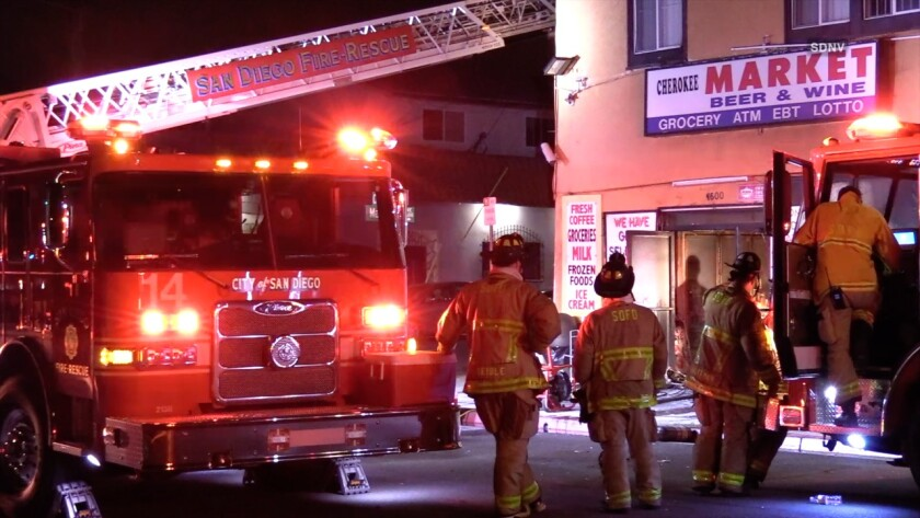 San Diego firefighters extinguished a fire at a Normal Heights market and liquor store early Tuesday and investigators are trying to determine what sparked the fire. Damage to the store and its contents was estimated to be around $200,000.