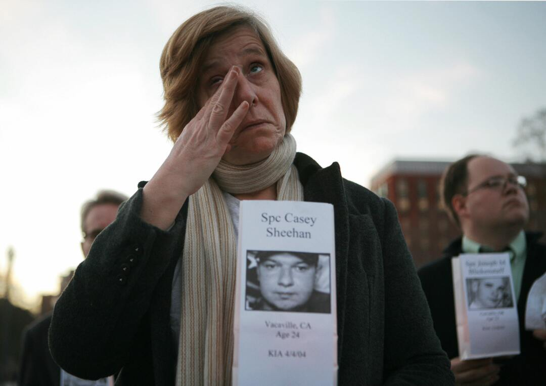 Peace activist Cindy Sheehan holds a picture of her son Casey Sheehan, who was killed in Iraq.