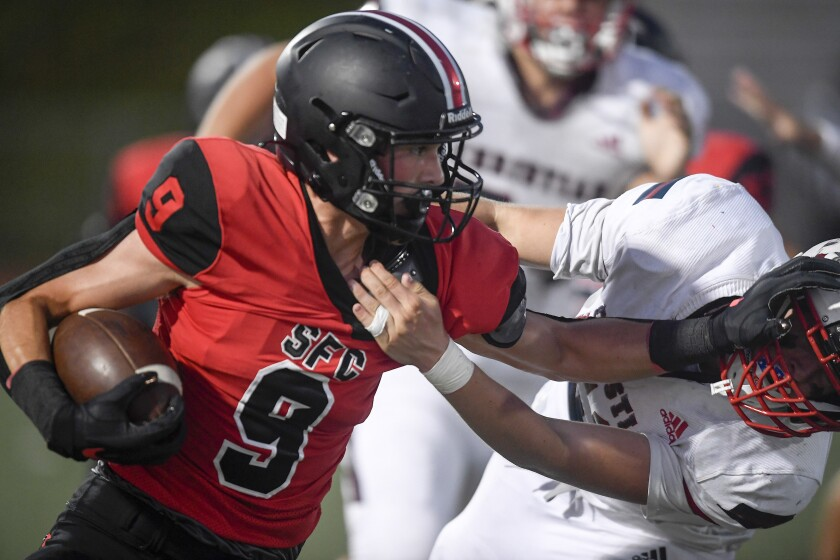 Santa Fe Christian's Cooper Whitton is a top running back and defensive end, but he'll play baseball in college.
