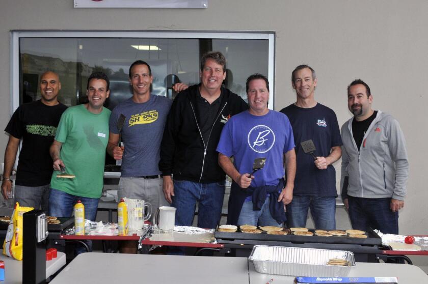 Dad's Club members preparing breakfast