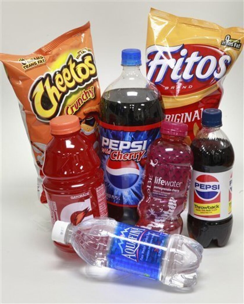 In this Feb. 25, 2010 photo, PepsiCo products, including drinks and snack food, are arranged for a photo in Providence, R.I. PepsiCo. on Monday, March 1, 2010, reiterated its 2010 earnings prediction after it completed the purchase of its two biggest bottlers.(AP Photo/Steven Senne)