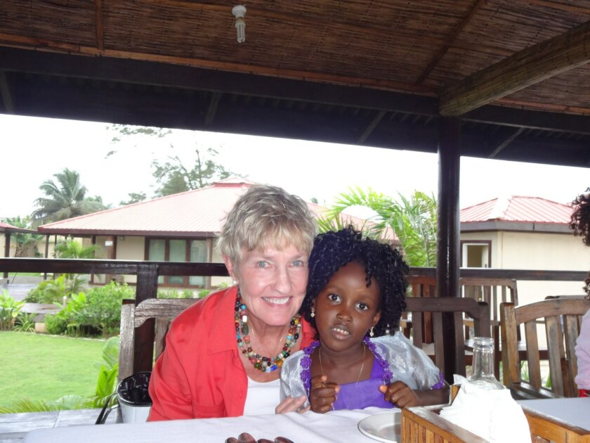 Deborah Lindholm in Liberia with a 6-year-old girl who was named Deborah in honor of the founder of the nonprofit Foundation For Women.