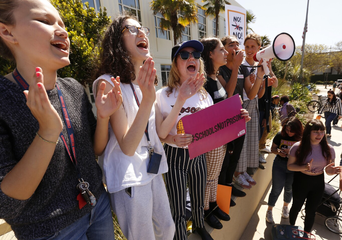 From left, Sara Umgerleider, Kayla Kane, Lily Alexander, and Vivian Predock, from Crossroads High School, joined several hundred students from area High Schools and Middle Schools as they coverged on Santa Monica City Hall to mark the 19th anniversary of the Columbine High School massacre.