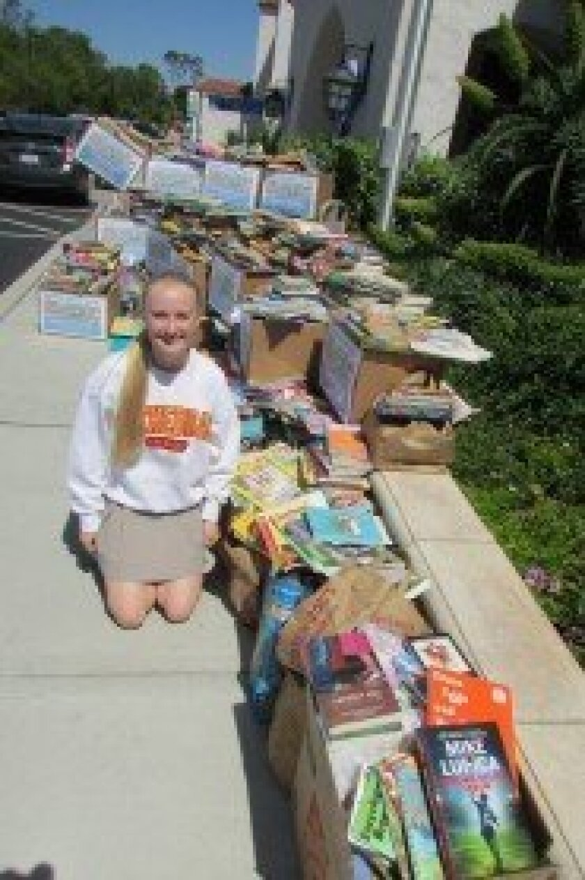 Current Cathedral Catholic student and R. Roger Rowe School graduate Sarah Lackey led a Books for Friends drive at her alma mater. Photo by Karen Billing