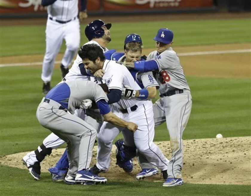 The Dodgers haven't been the same since the incident between Padres left fielder (center, without hat) and L.A. pitcher Zack Greinke at Petco Park on Aug. 11. (AP Photo/Lenny Ignelzi)