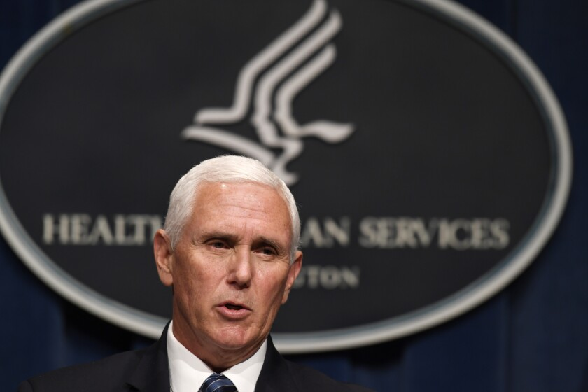 Vice President Mike Pence speaks at a coronavirus task force news conference at the Health and Human Services Department.