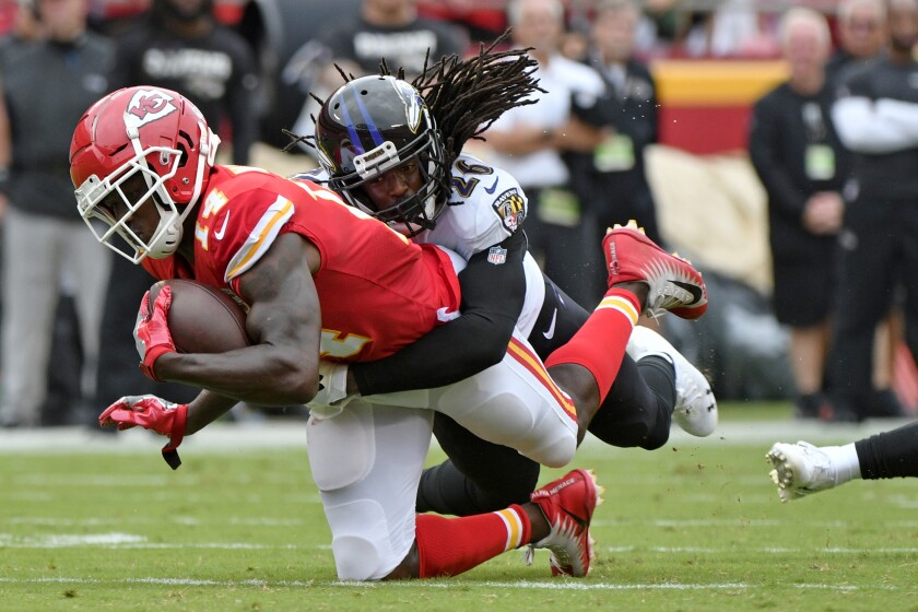 Chiefs receiver Sammy Watkins (14) is tackled by Ravens cornerback Maurice Canady after a reception during the first half Sunday.