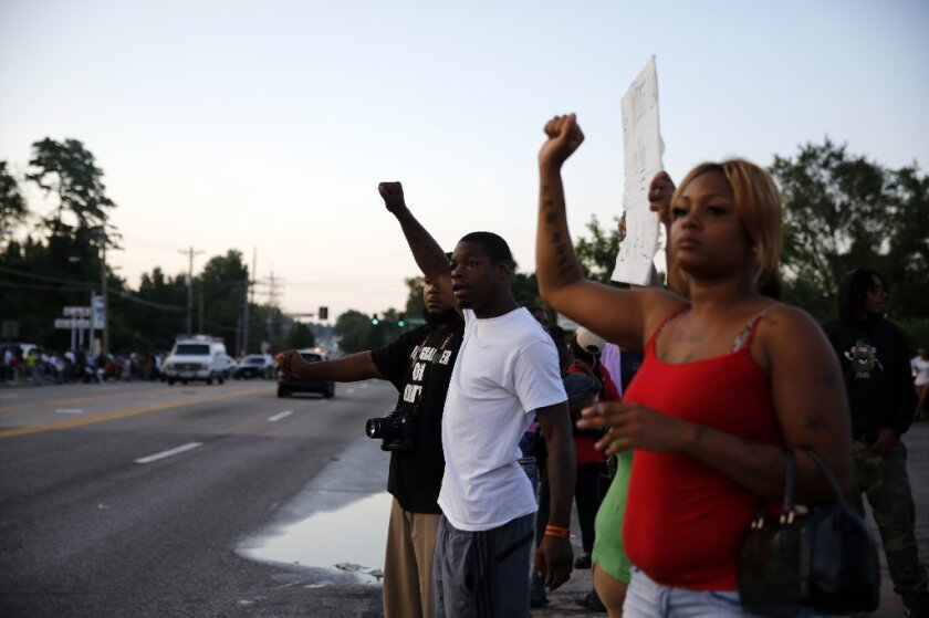 An Aug. 11 protest in Ferguson, Mo., over the fatal shooting of Michael Brown.