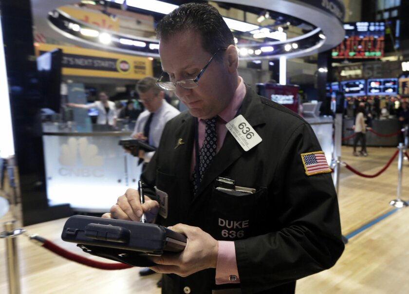 Trader Edward Curran works on the floor of the New York Stock Exchange Wednesday, Jan. 8, 2014.Stocks are mostly lower in early trading as investors hold back ahead of the release of the latest news from the Federal Reserve. (AP Photo/Richard Drew)