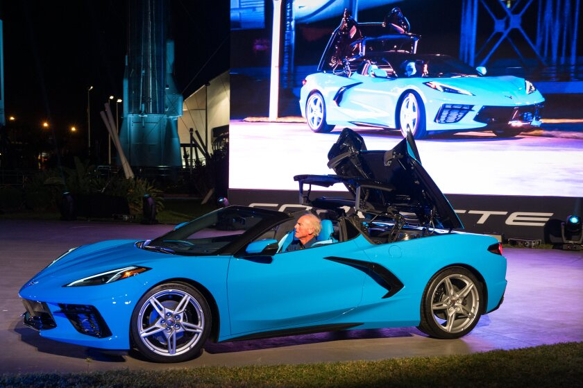 Corvette Executive Chief Engineer Tadge Juechter drives the 2020 Chevrolet Corvette Stingray convertible onto the stage during its debut Wednesday, Oct. 2, 2019 at the Kennedy Space Center in Cape Canaveral, Fla.