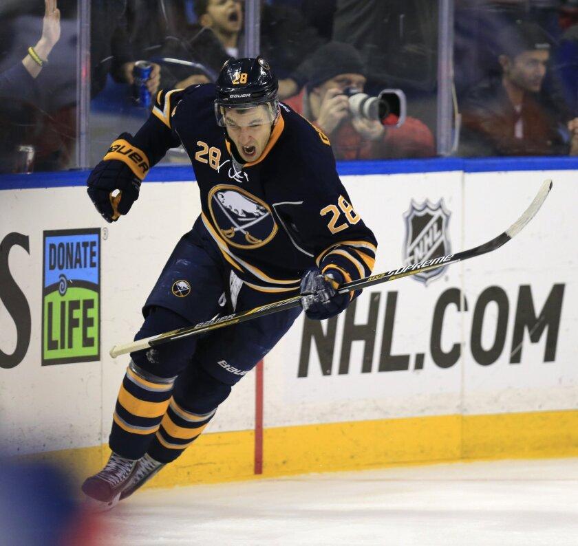Buffalo's Zemgus Girgensons celebrates after a goal against the New York Islanders in Buffalo on Dec. 27.
