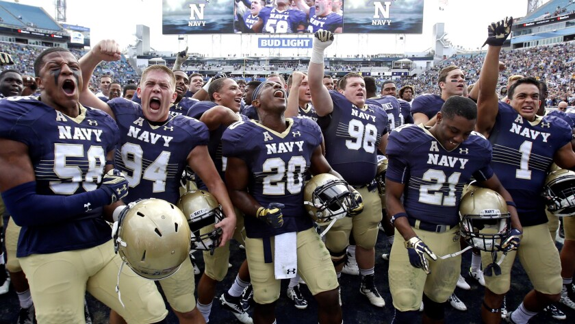 Navy celebrates a victory over Notre Dame in 2016.
