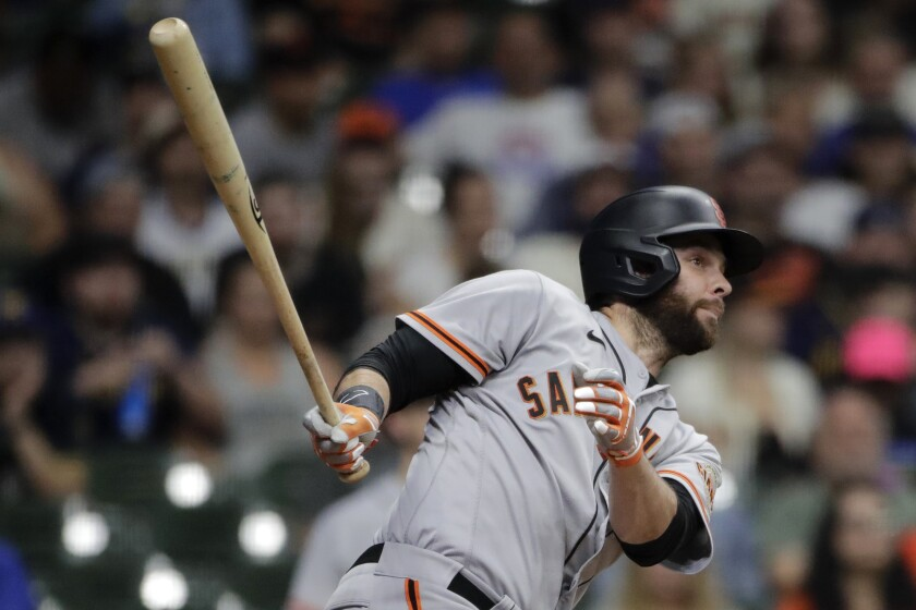 San Francisco Giants' Brandon Belt watches his two-run home run during the 11th inning of the team's baseball game against the Milwaukee Brewers on Saturday, Aug. 7, 2021, in Milwaukee. (AP Photo/Aaron Gash)