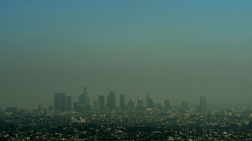 Heavy smog shrouds the Los Angeles skyline in 2015.