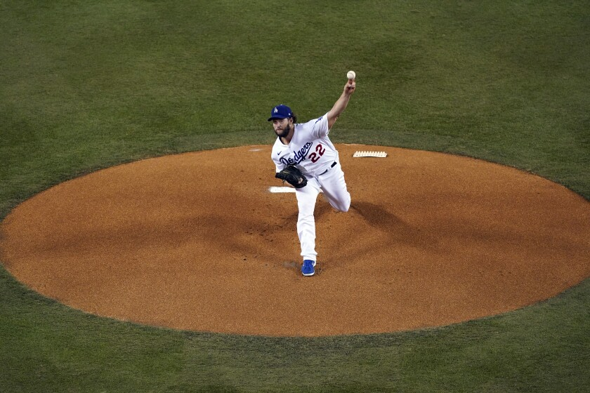 Clayton Kershaw throws against the Milwaukee Brewers.