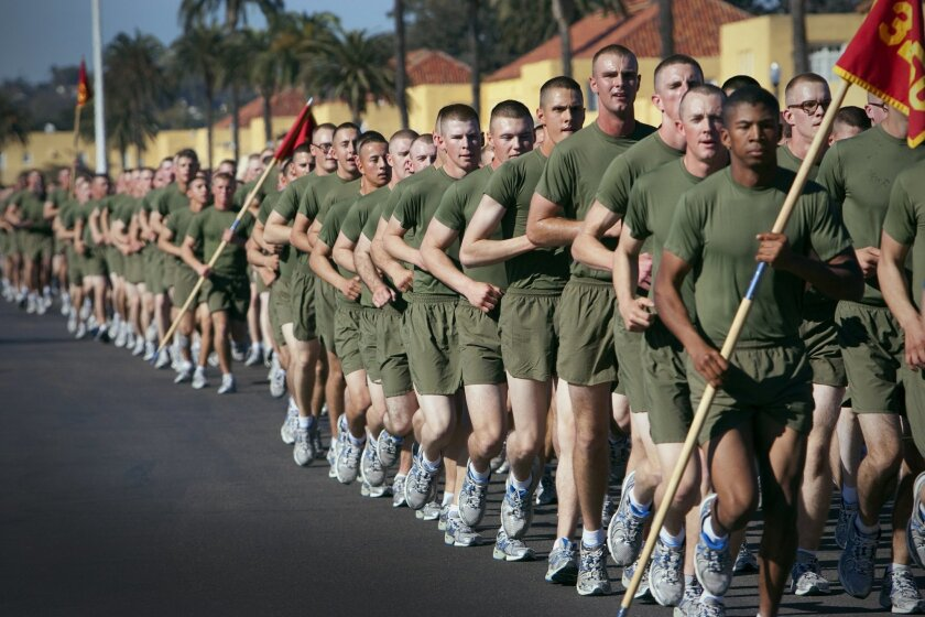 Marine recruits about to graduate in January 2011 from boot camp do a fun run with their drill instructors during family day at the Marine Corps Recruit Depot San Diego.