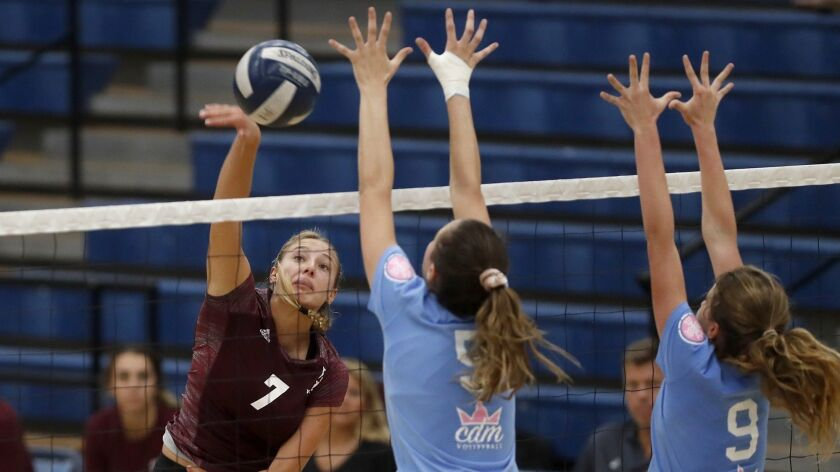 Laguna Beach High's Cambria Hall (7) scores against Corona del Mar during the second set in a Sunset