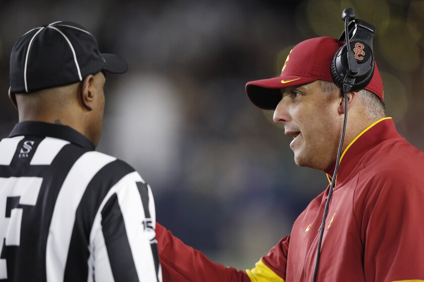 USC coach Clay Helton talks with an official during the Trojans' 30-27 loss at No. 9 Notre Dame.