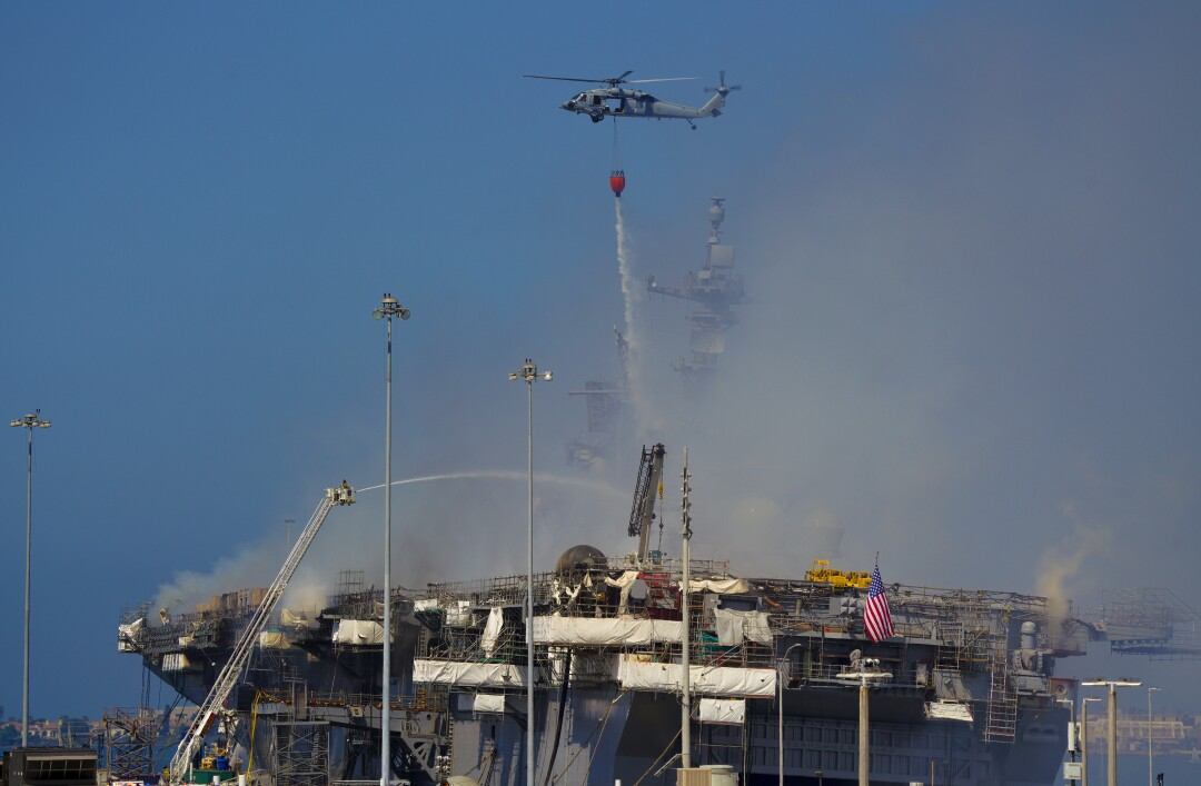 The Navy used helicopters for water drops