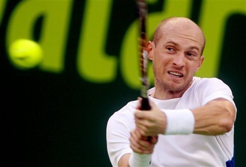 Russia's Nikolay Davydenko returns the ball to Russia's Mikhail Youzhny during the Qatar ATP Open Tennis tournament in Doha, Qatar, Wednesday, Jan. 2, 2013. (AP Photo/Osama Faisal)