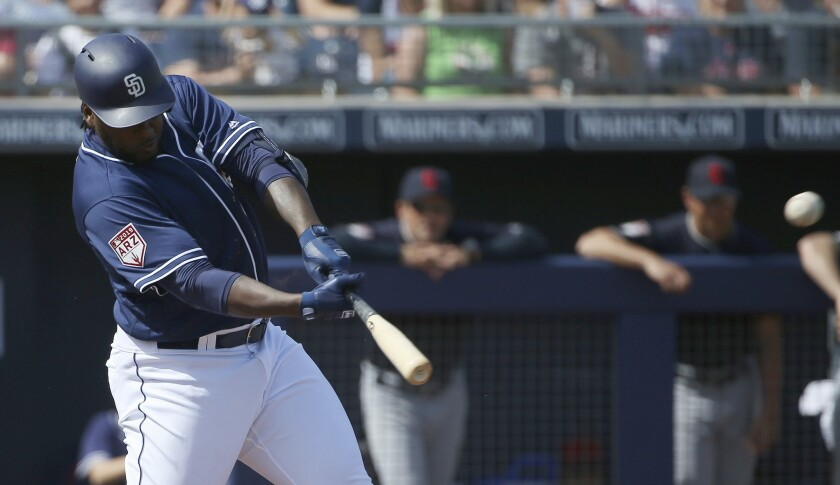 San Diego Padres' Franmil Reyes connects for a run-scoring double against the Cleveland Indians duri