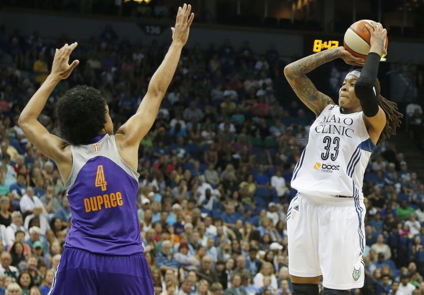 Minnesota Lynx guard Seimone Augustus (33) shoots the ball against Phoenix Mercury forward Candice Dupree (4) in the second half of a WNBA basketball game, Thursday, July 31, 2014, in Minneapolis. The Lynx won 75-67. (AP Photo/Stacy Bengs)