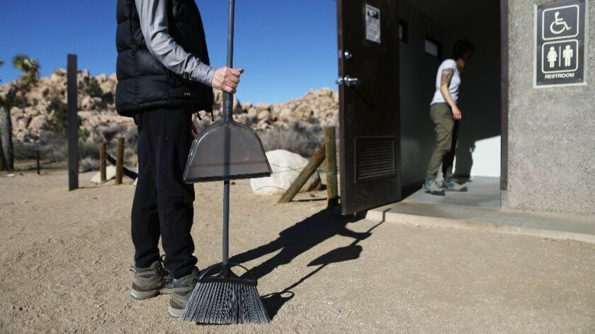 Volunteers prepare to clean a restroom at Joshua Tree National Park on Jan. 4.
